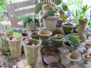 handmade mossy pots on market table