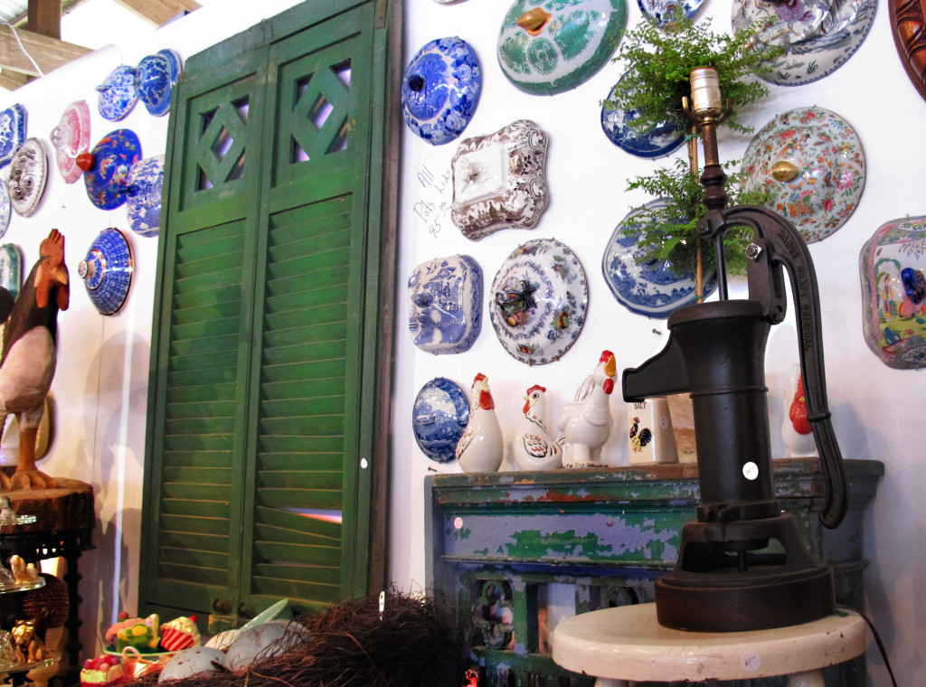 Different colored antique tureen lids displayed on wall