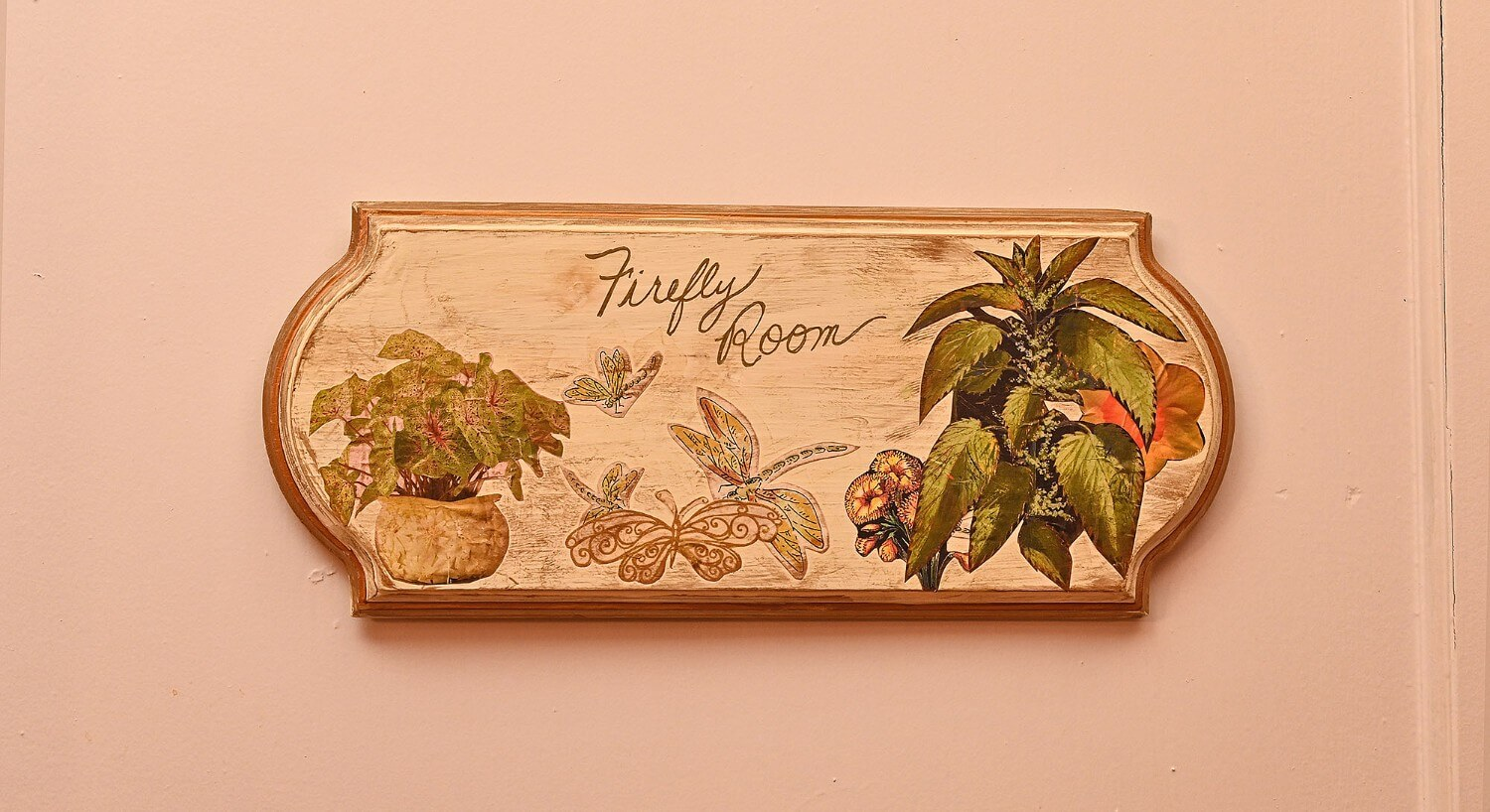 "Weathered cream rectangular sign with painted flowers and text ""firefly room"""